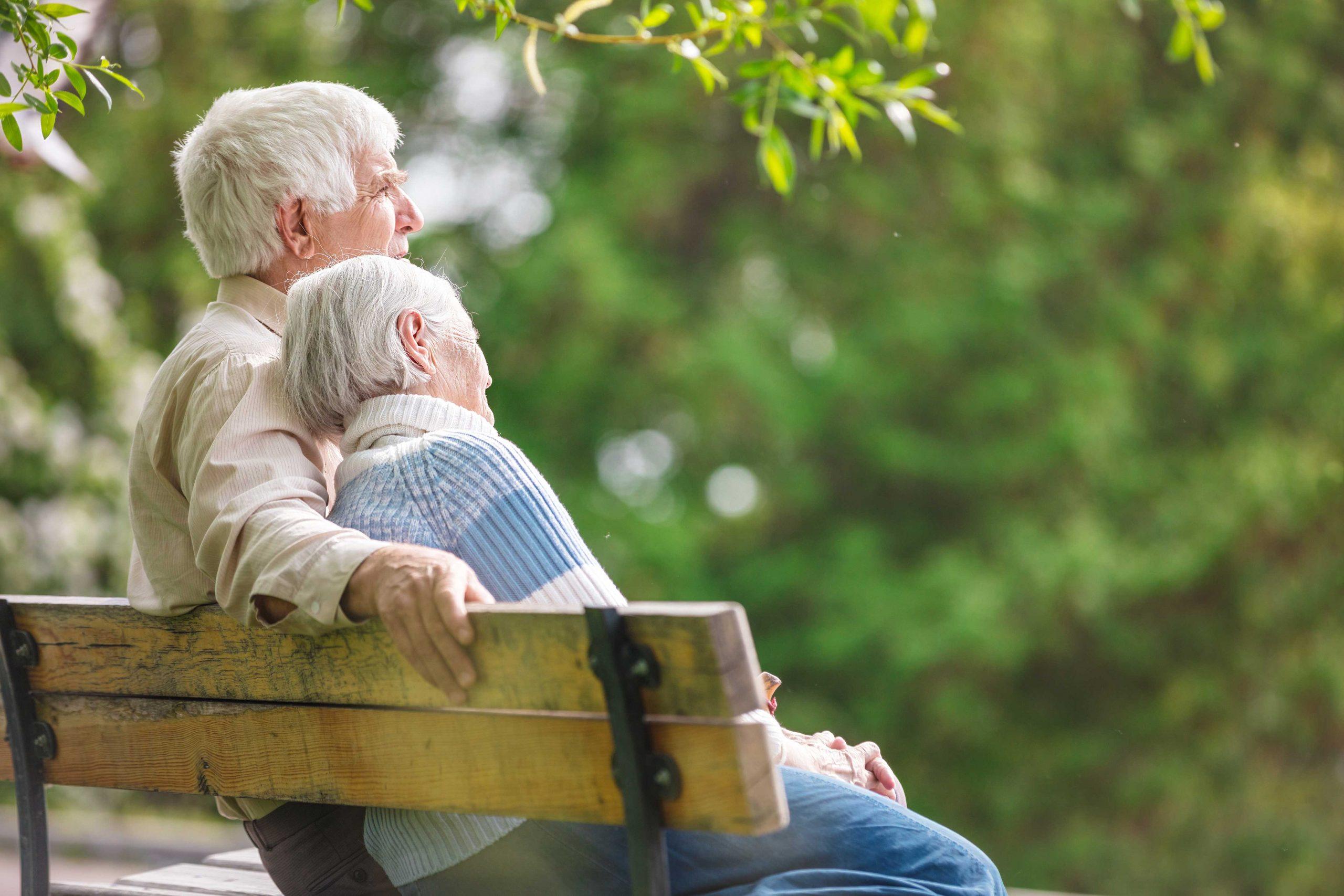 Senior couple sitting on bench outside